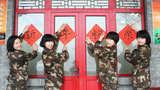 首都瑞雪喜迎元旦 火红女兵新年祈愿