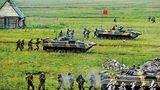"""2013年7月,""""和平使命—2013""""中俄联合反恐军事演习在俄罗斯切巴尔库尔综合训练场举行。"""