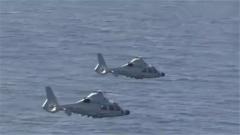 南海某海域 舰载直升机进行导弹实射训练
