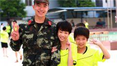 全国助残日:河池武警官兵与折翼天使在一起
