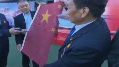 一面残缺的国旗,印证着这些老兵坚守南沙的铮铮誓言