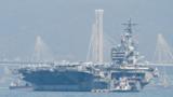 """2018年11月21日,美军核动力航母""""里根""""号战斗群访问香港。""""里根""""号是美军第9艘尼米兹级核动力航母,2003年开始服役,目前以日本横须贺美军基地为母港。"""