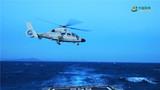 航行状态下舰载直升机起降。