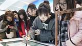 """11月24日,观众在""""伟大的变革——庆祝改革开放40周年大型展览""""上体验中科智能书法台。新华社记者 殷刚 摄"""