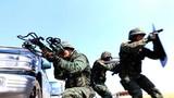 2018年3月,武警大理支队特战官兵在野外开展武力突击训练。