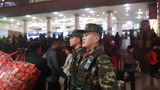 武警官兵定点执勤,确保旅客安全。