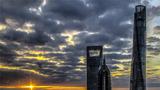 2018年11月2日,上海环球金融中心、上海金茂大厦和上海中心大厦沐浴在晨光之中。新华社记者 殷刚 摄