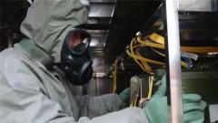 全身防護+兩道防護門 訓練用毒劑運輸不容大意