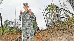 杜富国:我常梦到战友们唱着军歌踏入雷场
