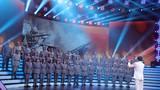 圖為新四軍老戰士合唱團官唱響軍歌《游擊隊之歌》。