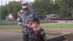 6个月没见过军人爸爸 军娃参加军事夏令营与父亲军营团聚