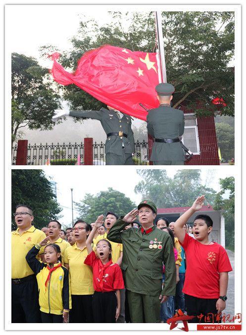 009-南部战区陆军某边防旅二营及瑞丽全市各部门党员领导干部、学生代表、群众党员代表等到姐告国门共庆祖国华诞,举行升旗仪式。