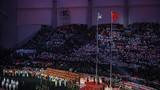 中华人民共和国国旗和国际军事体育理事会会旗迎风飘扬