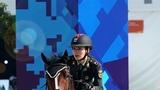 10月21日,军运会马术场地障碍赛上,中国女选手田羽(下士)在比赛中。柳军 摄