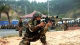 """近日,武警广西总队第二片区""""魔鬼周""""极限训练正在如火如荼地展开,该片区坚持快、准、好的训练标准,组织特战队员开展了自动步枪快速射击、突入识别射击、两公里奔袭射击等多个实弹射击科目的加强训练。图为狙击手进行跪姿射击。"""