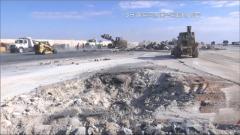 美军对受袭伊拉克阿萨德空军基地展开清理