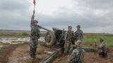 泥泞的炮阵地上,全班合力精准打击目标
