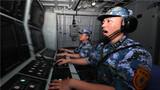 定州艦對空戰位按下發射鍵。