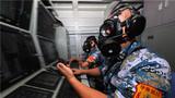 戰位開展防核防化學防生物武器部署訓練。