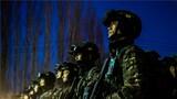 """近日,武警新疆总队塔城支队开展为期7天6夜的""""魔鬼周""""极限训练,全面锤炼官兵应对复杂情况的综合实战能力。图为整装待发。"""