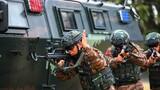 近日,武警广东总队梅州支队从难从严组织官兵开展战术、攀登、红蓝对抗等演练,锤炼特战队员协同作战能力。