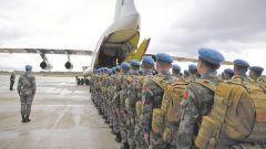 军队代表委员热议维护世界和平履行大国担当