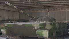 圆形炮塔 100毫米口径火炮 它是我国第一代水陆两栖坦克!